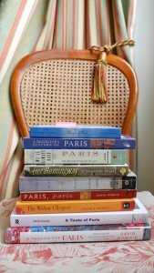Chair with stack of books about Paris and Champagne, Hemingway, Angels