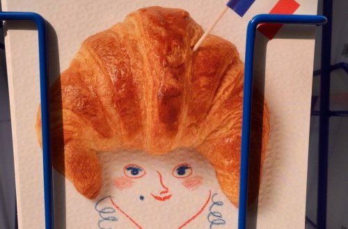postcard with croissant head Bring France Home