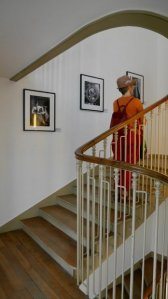 Willy Ronis visitor walking up stairs for the exhibit