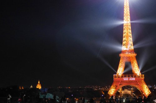 Image of Eiffel Tower, Invalides in background, 130 years