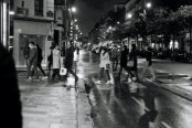 Parisians crossing the street at a crosswalk