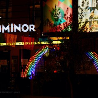 Image of the movie theater Luminor and rainbow colors reflection