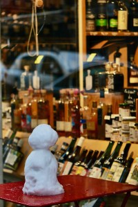 A Snow Day in Paris Image of snow man looking at the store window