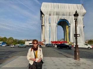 Colleen in front of the Arc de Triomphe Wrapped almost