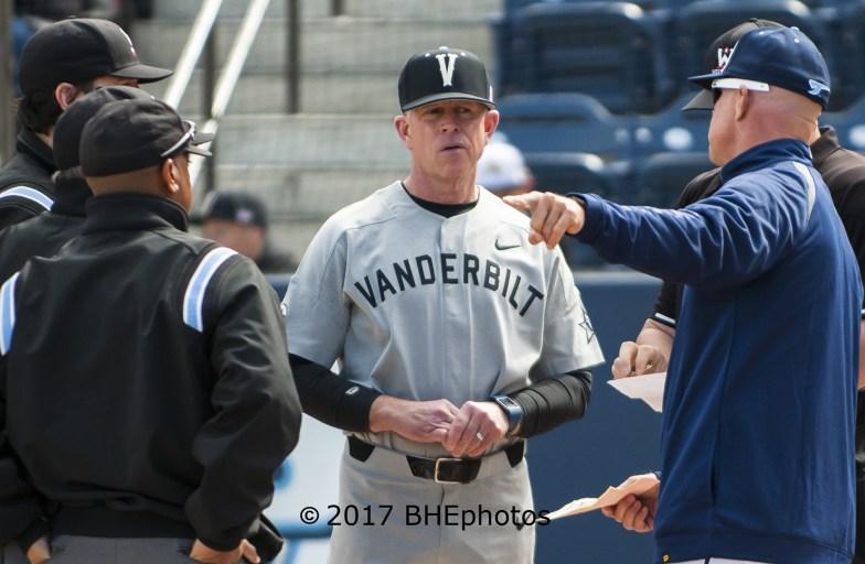 Vanderbilt Manager, Tim Corbin listens to pregame instructions from SUD head coach Rich Hill - Photo By David Cohen, BHEphotos
