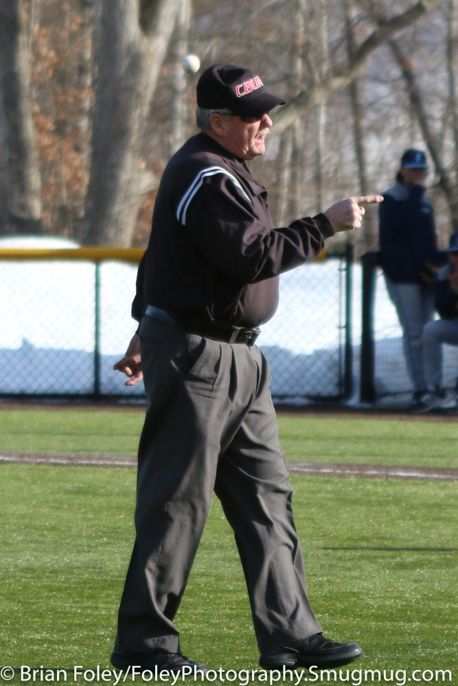 Monday, March 20, 2017; Northboro, MA; Umpire Richard Galvin officially warns WPI Engineers head coach Mike Callahan during the Engineers come from behind 9-7 victory over the Scots at the New England Baseball Complex.