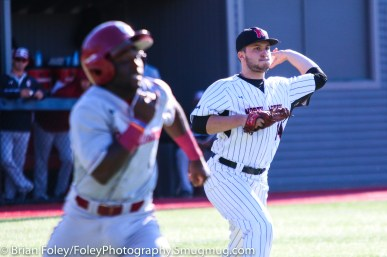 Friday, April 14, 2017; Brookline, MA; Northeastern Huskies pitcher Andrew Misiaszek (14) makes a throw to first base to throw out College of Charleston infielder Dupree Hart (5) during the Huskies 6-3 victory over the Cougars in a CAA matchup at Parsons Field.