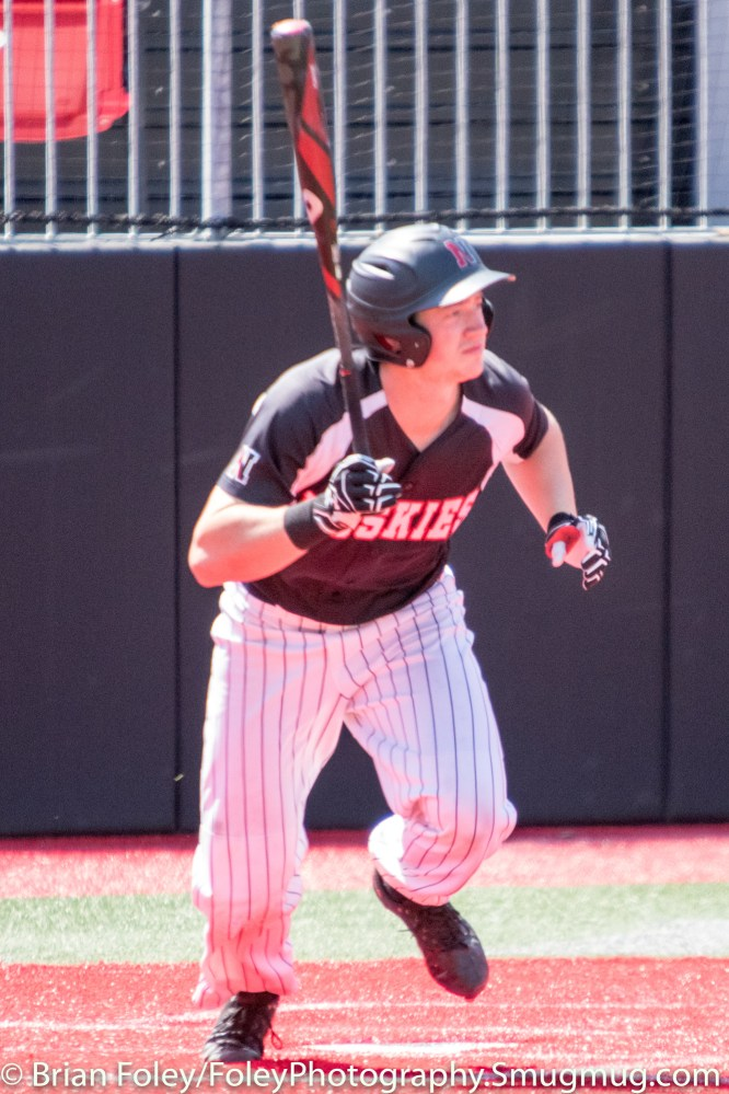 Sunday, April 16, 2017; Brookline, MA; Northeastern Huskies infielder Charlie McConnell (9) follows his hit during the Huskies 6-3 victory over the Cougars in a CAA matchup at Parsons Field.
