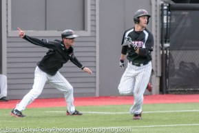 Sunday, April 16, 2017; Brookline, MA; Northeastern Huskies infielder Scott Holzwasser (28) is waved home by Northeastern assistant coach Kevin Casey during the Huskies 6-3 victory over the Cougars in a CAA matchup at Parsons Field.