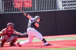 Sunday, April 16, 2017; Brookline, MA; Northeastern Huskies infielder Cam Hanley (10) follows through on a hit during the Huskies 6-3 victory over the Cougars in a CAA matchup at Parsons Field.