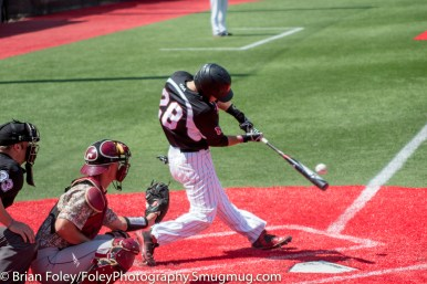 Sunday, April 16, 2017; Brookline, MA; Northeastern Huskies infielder Scott Holzwasser (28) swings for a pitch during the Huskies 6-3 victory over the Cougars in a CAA matchup at Parsons Field.