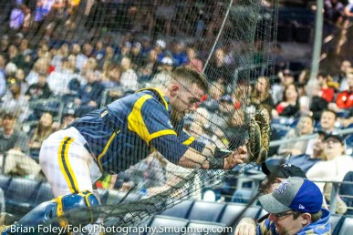 Tuesday, April 11, 2017; Hartford, CT; Quinnipiac catcher Evan Vulgamore (5) crashes into the net behind the plate during the Hawks 6-4 victory over the Bobcats at Dunkin Donuts Park.