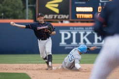 Timmy Richards turns a double play in the 3rd inning. CSUF defeated UCLA 4-3, Fullerton, CA, May 9, 2017. Photo by Steve Cheng, BHEphotos.