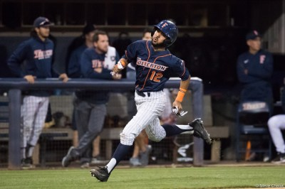 Sahid Valenzuela scores in the 5th inning to give CSUF a 2-0 lead. CSUF defeated UCLA 4-3, Fullerton, CA, May 9, 2017. Photo by Steve Cheng, BHEphotos.