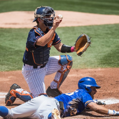 Chris Hudgins tags out Billy Fredrick at home in the 1st inning after Hunter Cullen's throw from right field. CSUF defeated UCSB 12-3, Fullerton, CA, May 14, 2017. Photo by Steve Cheng, BHEphotos.