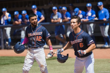 Sahid Valenzuela celebrates Scott Hurst's 2-run home run in the 3rd inning. CSUF defeated UCSB 12-3, Fullerton, CA, May 14, 2017. Photo by Steve Cheng, BHEphotos.