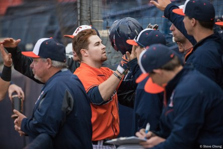 Tristan Hildebrandt is congratulated in the dugout after scoring on a sacrifice fly by Dillon Persinger in the 3rd inning. Saint Mary's defeated CSUF 12-4, Fullerton, CA, May 15, 2017. Photo by Steve Cheng, BHEphotos.