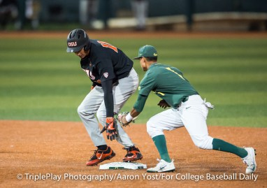 Oregon State designated hitter Trevor Larnach (11) maintains contact with second base after doubling against Oregon and Kyle Kasser (1) during Thursday's Pac-12 game at PK Park in Eugene.
