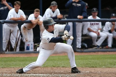 Friday, May 12, 2017; Storrs, CT; Connecticut Huskies outfielder John Toppa (27) attempts to bunt during the Huskies 2-1 victory over the Bulls.