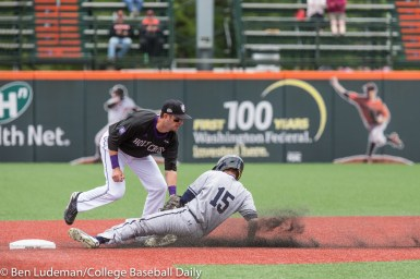Corvallis, OR - JUNE 4: Alex Stiegler (15) of the Yale Bulldogs is tagged out by Cam O'Neill (13) of the Holy Cross Crusaders during a 9-5 Yale Bulldogs victory over the Holy Cross Crusaders in an NCAA Championship Regional Playoff game on June 4, 2017 at Goss Stadium on the campus of Oregon State University in Corvallis, OR (Photo by Ben Ludeman)