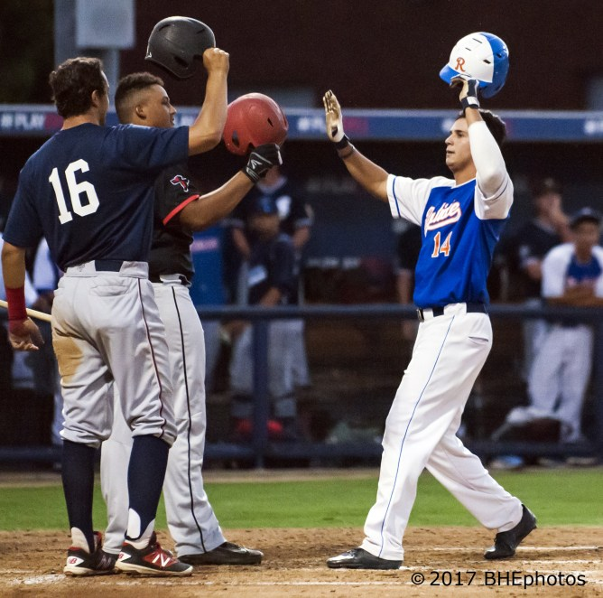 David Miranda is greeted at home after hitting a 2 run home run to give the south a 4-2 lead - Photo By David Cohen, BHEphotos