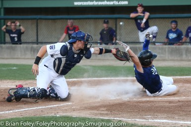 7/11/17, Hanover Insurance Park at Fitton Field Worcester, MA: USA Collegiate National Team catcher Grant Koch (33) of Arkansas attempts to tag Futures League's Jake Fresca of Sacred Heart University during the USA Collegiate Team's 6-4 victory over the Futures League Prospects Team at Hanover Insurance Park at Fitton Field..