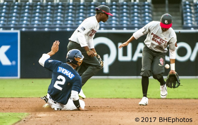 Alek Thomas slides steels second and advances to third after Kevin Vargas can't hang onto the throw in the dirt. 2017 Perfect Game All American Game - Photo By David Cohen, BHEphotos