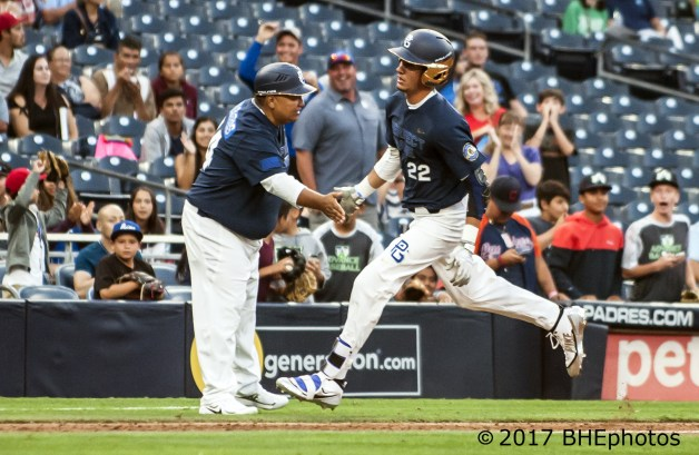 Jordan Groshans igives Manny Hermosillo, Jr 5 as he rounds third after hitting a home run. 2017 Perfect Game All American Game - Photo By David Cohen, BHEphotos