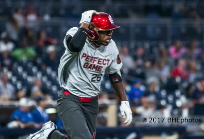 Kendall Logan Simmons hangs onto his helmet as he races down the first base line. 2017 Perfect Game All American Game - Photo By David Cohen, BHEphotos