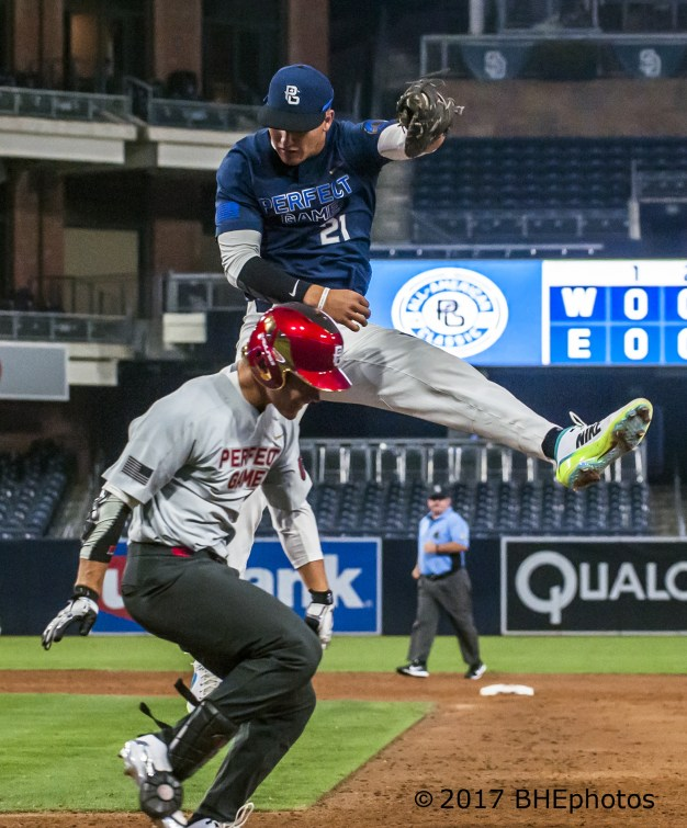 Hunter Watson makes his own saving catch. 2017 Perfect Game All American Game - Photo By David Cohen, BHEphotos