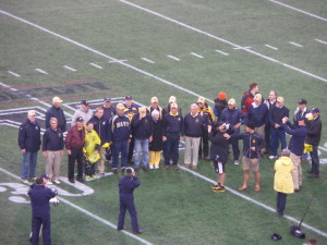 The 1960 Navy Cotton Bowl team was honored between after the first period of the Air Force game.