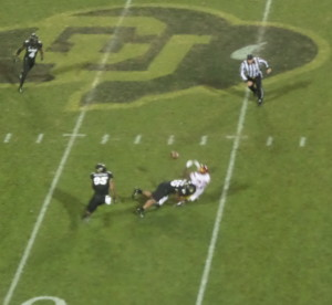 Grant Wanatabe's break up of this pass stopped the Trojan drive to force a punt for CU's last chance to at least even the score.