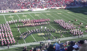 United States Army and Rutgers Marching bands perform together at halfime.