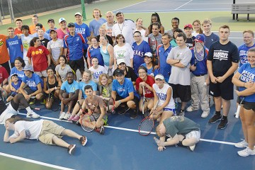 Students, faculty and athletes gather for a photo after an afternoon of tennis fun on the Collin College courts.