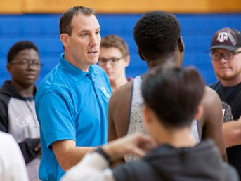 Will Mitchell (in blue) explains the rules for dodge ball at an introductory game at Spring Creek Campus (pictured above) in November.