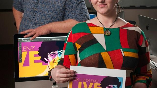 associate professor Kevin Kreneck and student Cari Croninger with her winning artwork