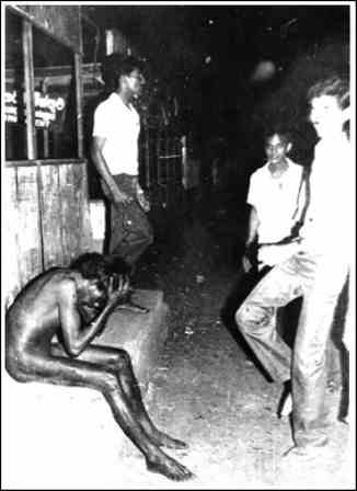 The crimes of July 1983 were a watershed for our country | pic by Chandraguptha Amarasingha - A Tamil boy stripped naked and later beaten to death by Sinhala youth in Boralla gustation - 1983 July