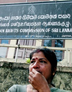 A woman cries outside the Human Right Commission office in Jaffna