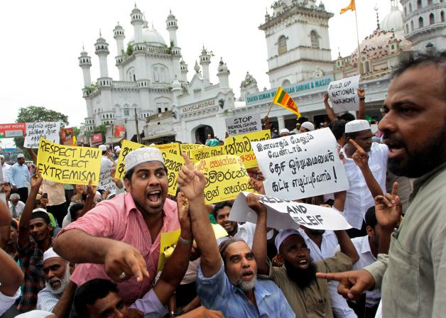 Sri Lankan Muslims protest after Friday prayers outside a mosque in Colombo, Sri Lanka, Friday, April 27, 2012