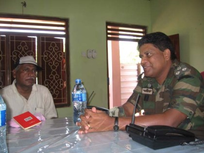 "Reddy with Major-General Shavindra Silva of the 58th Brigade at the SL Army base camp at Kilinochchi on 13th May when Reddy and Prasad were given a briefing and where the General ""asked us what we needed for reporting purposes"" (email from Reddy to Roberts, 28 Dec. 2013)"