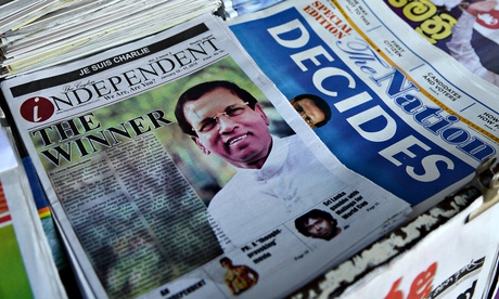 Newspapers at a stall in Colombo show headlines about Sri Lanka's new president Maithripala Sirisena