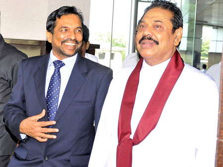 Director General of Customs, Jagath Wijeweera with the President Mahinda Rajapaksa
