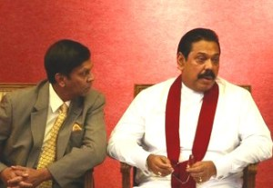 Rajapaksa, Cabraal, Basil Rajapaksa speak during the presentation of the Central Bank of Sri Lanka annual report 2010, in Colombo