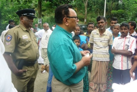 Minister Haleem in conversation with residents requiring road access