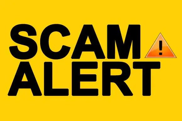 a yellow sign that says scam alert
