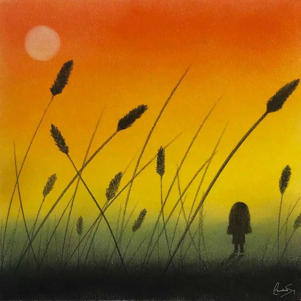 wheat leaves over yellow and orange sunset