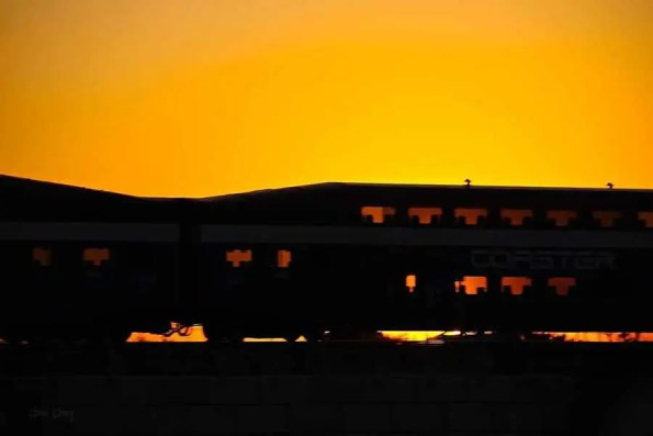 An empty train car in the sunset