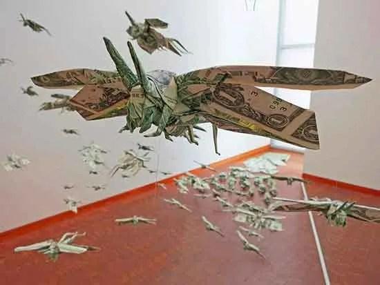 an origami of butterflies made with dollar bills