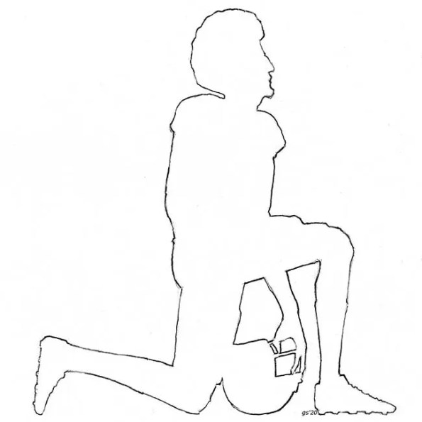 A silhouette of a football player kneeling