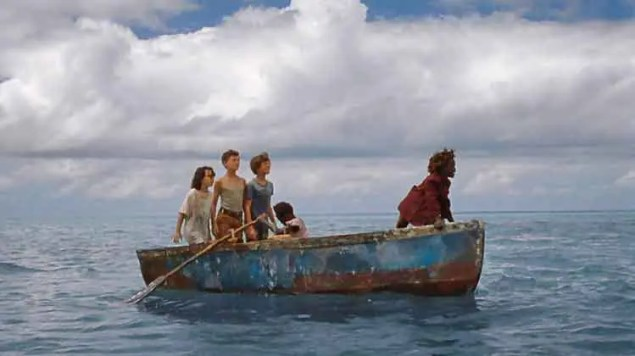 a boat in the middle of the ocean with children in it